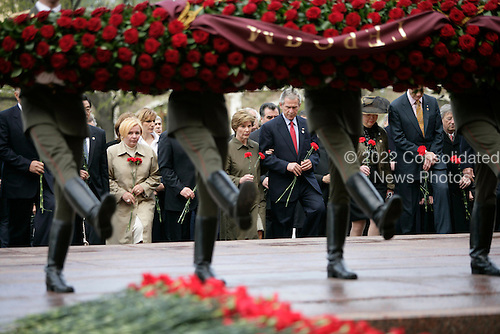 United States President George W. Bush and first lady Laura Bush join world leaders in a wreath laying ceremony Commemorating the 60th Anniversary of the end of World War II at the Tomb of the Unknown Soldier at the Kremlin Wall, Moscow, Russia, Monday, May 9, 2005. <br /> Credit: Eric Draper - White House via CNP