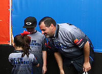Feb 22, 2015; Chandler, AZ, USA; NHRA pro stock driver Chris McGaha with his kids during the Carquest Nationals at Wild Horse Pass Motorsports Park. Mandatory Credit: Mark J. Rebilas-
