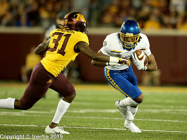 MINNEAPOLIS, MN - AUGUST 29: Adam Anderson #80 from South Dakota State University tries to make move past Kiondre Thomas #31 from the University of Minnesota during their game Thursday night at TCF Bank Stadium in Minneapolis, MN. (Photo by Dave Eggen/Inertia)