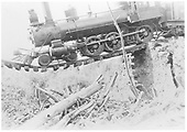 RGS 4-6-0 #25 (1st) hanging on Starvation Creek Trestle rails (Bridge 138-A).<br /> RGS  Starvation Creek, CO  8/14/1909