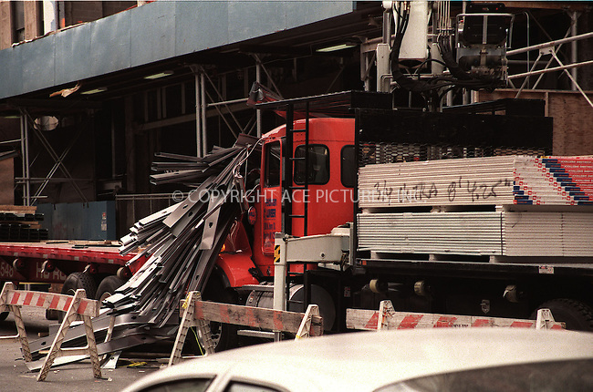 Construction accident at 33Rd Street and Eight Avenue in New York.  Construction material fell down on a crain injuring at least one man.  15 May 2001.  Please byline: Alecsey Boldeskul/NY Photo Press.   ..*PAY-PER-USE*      ....NY Photo Press:  ..phone (646) 267-6913;   ..e-mail: info@nyphotopress.com