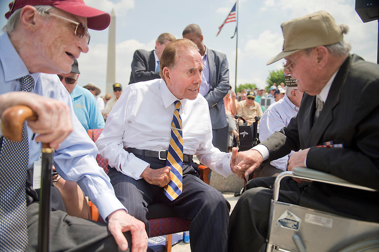 UNITED STATES - MAY 8: From left, former Sens. John Warner, R-Va., Bob Dole, R-Kan., Army veteran Ki Faulkner, 91, of Harper's Ferry, Va., talk during a ceremony at World War II Memorial on the Mall to commemorate the 70th anniversary of the victory in Europe, known as VE Day, May 8, 2015, which featured flyovers by World War II era aircraft. Warner served in the Navy and Marines and Dole was wounded in WWII while serving in the Army.(Photo By Tom Williams/CQ Roll Call)