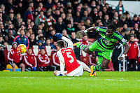 Bafetibi Gomis of Swansea City  takes a tumble over Gabriel Paulista of Arsenal  during the Barclays Premier League match between Arsenal and Swansea City at the Emirates Stadium, London, UK, Wednesday 02 March 2016