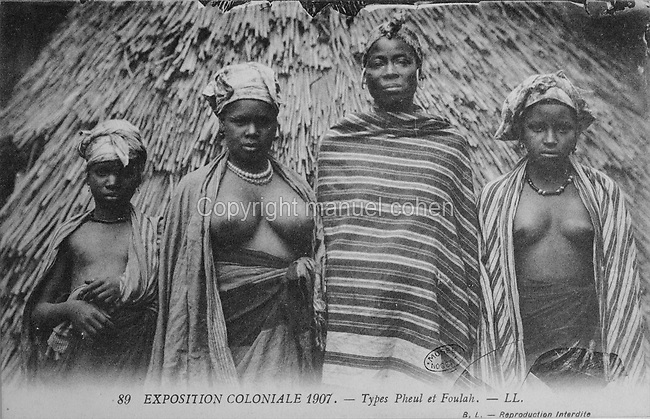 Fula women from West Africa at the Colonial Exhibition of 1907, held in the Jardin d'Agronomie Tropicale, or Garden of Tropical Agronomy, in the Bois de Vincennes in the 12th arrondissement of Paris, postcard from the nearby Musee de Nogent sur Marne, France. The garden was first established in 1899 to conduct agronomical experiments on plants of French colonies. In 1907 it was the site of the Colonial Exhibition and many pavilions were built or relocated here. The garden has since become neglected and many structures overgrown, damaged or destroyed, with most of the tropical vegetation disappeared. The site is listed as a historic monument. Picture by Manuel Cohen / Musee de Nogent sur Marne