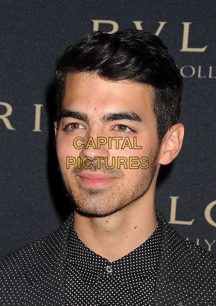 WEST HOLLYWOOD, CA- FEBRUARY 25: Musician Joe Jonas arrives at the BVLGARI 'Decades Of Glamour' Oscar Party Hosted By Naomi Watts at Soho House on February 25, 2014 in West Hollywood, California.<br /> CAP/JOR<br /> &copy;Nils Jorgensen/Capital Pictures