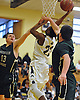 Elijah Bovell #23 of Baldwin, center, drives to the basket during a non-league game against Harborfields in the Richard Brown Nassau-Suffolk Challenge at Uniondale High School on Saturday, Jan. 14, 2017. Baldwin won by a score of 49-42.