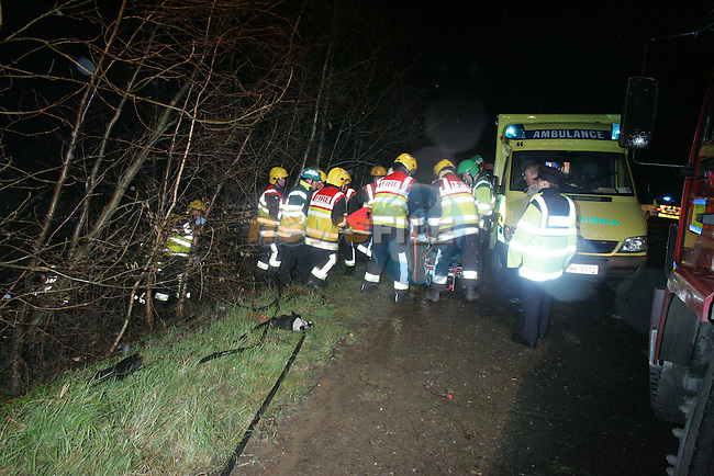 Fire Units from Drogheda, Dunleer and Dundalk attended the scene of a single vehicle accident on the north side of Dunleer on the old N1 road, The vehicle left the road crashing into young trees and coming to rest at the bottom of a small embankement and covered by the fallen trees. Ambulance from Drogheda and Dundalk took the 3 occupants to hospital in Drogheda..Photo: Fran Caffrey/ Newsfile.