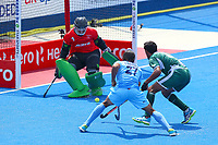 Pakistan goalkeeper Amjad Ali saves a shot from Akashdeep Singh of India during the Hockey World League Semi-Final match between Pakistan and India at the Olympic Park, London, England on 18 June 2017. Photo by Steve McCarthy.
