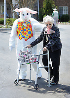SOUTHAMPTON, PA - APRIL 17:  The Easter Bunny accompanies Lucille Deigendesch during an Easter Egg hunt for residents at Southampton Estates April 17, 2014 in Southampton, Pennsylvania. (Photo by William Thomas Cain/Cain Images)