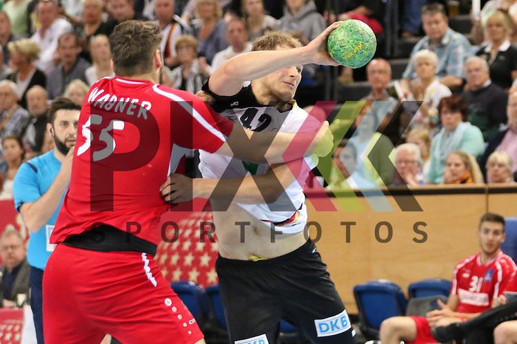 Kiel, 14.06.15, Sport, Handball, L&auml;nderspiel, EM-Qualifikation, Deutschland - &Ouml;sterreich : Tobias Wagner (HC Fivers WAT Margareten / &Ouml;sterreich, #55), Paul Drux (F&uuml;chse Berlin / Deutschland, #42)<br /> <br /> Foto &copy; P-I-X.org *** Foto ist honorarpflichtig! *** Auf Anfrage in hoeherer Qualitaet/Aufloesung. Belegexemplar erbeten. Veroeffentlichung ausschliesslich fuer journalistisch-publizistische Zwecke. For editorial use only.