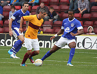 Keith Lasley being closed down by Victor Anichebe in the Motherwell v Everton friendly match at Fir Park, Motherwell on 21.7.12 for Steven Hammell's Testimonial.