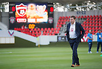 Spartak Trnava v St Johnstone...07.08.14  Europa League Qualifier 3rd Round<br /> Saints boss Tommy Wright checks out the playing surface at the Fc Vion Stadium prior to kick-off<br /> Picture by Graeme Hart.<br /> Copyright Perthshire Picture Agency<br /> Tel: 01738 623350  Mobile: 07990 594431