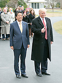 United States President Donald J. Trump and Prime Minister Shinzō Abe of Japan pose for the photographers as they depart the South Lawn of the White House in Washington, DC on Friday, February 10, 2017.  The two leaders are scheduled to have dinner with their wives at Mar-a-Lago in Florida.<br /> Credit: Ron Sachs / CNP