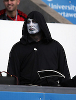 A Grim Reaper Halloween Swansea supporter during the Barclays Premier League match between Swansea City and Arsenal at the Liberty Stadium, Swansea on October 31st 2015