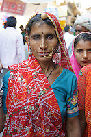 desert village woman proudly dressed up for her visit of camel fair in Pushkar