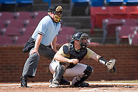 Catcher Mike Murray #15 of the Wake Forest Demon Deacons sets a target as home plate umpire Darren Spagnardi looks on at Wake Forest Baseball Park March 7, 2010, in Winston-Salem, North Carolina.  Photo by Brian Westerholt / Four Seam Images