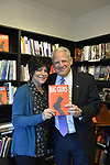 Rockville Centre, New York, USA. April 201, 2018. R-L, Rep. STEVE ISRAEL and RITA KESTENBAUM hold Israel's newest novel BIG GUNS as they pose for photo during special event for Nassau County debut of the former Congressman's (NY - Dem) book, which is a satire of the strong gun lobby, weak Congress, and a small Long Island town. Moderator RITA KESTENBAUM is a gun-control activist and former Town of Hempstead Councilwoman whose daughter was shot to death while at college.