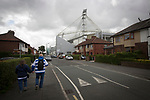 Two spectators walking towards the ground before Preston North End take on Reading in an EFL Championship match at Deepdale. The home team won the match 1-0, Jordan Hughill scoring the only goal after 22nd minutes, watched by a crowd of 11,174.