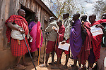 Maasai villagers form a line at the Predator Compensation Fund Pay Day, Mbirikani Group Ranch, Amboseli-Tsavo eco-system, Kenya, Africa, October 2012