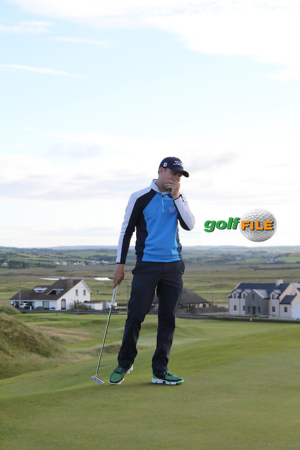 Paul McBride (The Island) on the 1st green during Matchplay Round 3 of the South of Ireland Amateur Open Championship at LaHinch Golf Club on Saturday 25th July 2015.<br /> Picture:  Golffile | TJ Caffrey