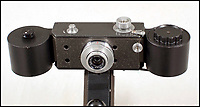 BNPS.co.uk (01202 558833)Pic: Astons/BNPS<br /> <br /> Motor-driven document copying camera.<br /> <br /> Cold War Collectables - Auction of Soviet spy camera's from behind the Iron Curtain reveal the KGB's cunning and ingenuity at the height of the Cold War.<br /> <br /> A fascinating collection of Russian spy cameras which were used clandestinely at the height of the Cold War have emerged for sale for &pound;60,000.<br /> <br /> The ingenious gadgets deployed by KGB operatives include cameras built into the sides of briefcases, buttons of jackets, umbrella handles and cigarette cases.<br /> <br /> The sale also features a clever 'Zenit' F-21 spy camera which shoots photos through the side of a camera case when it appears to be shut.<br /> <br /> There are also several 'Minox' cameras which are known as the 'James Bond' spy camera as one appeared in the film On Her Majesty's Secret Service (1969).