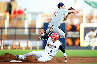 Cedar Rapids Kernels shortstop Eric Stamets #1 attempts to turn a double play as Colin Walsh #8 slides in during a game against the Quad Cities River Bandits at Modern Woodmen Park on June 30, 2012 in Davenport, Illinois.  Quad Cities defeated Davenport 8-7.  (Mike Janes/Four Seam Images)