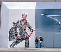 "Out takes from ""The Harvard Design School Guide to Shopping"" published by Tashen. A huge advertisement on the upper east side is put into perspective by two pedestrians walking infront of it. NY 2000"