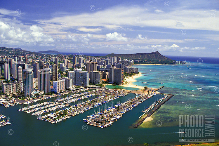 Aerial view of the Ala Wai yacht harbor, with Waikiki and Diamond Head in the backgrounmd.
