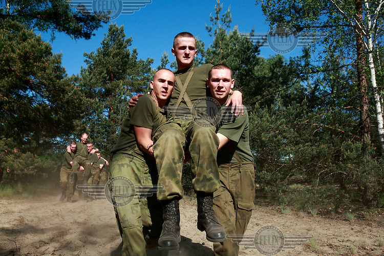Young soldiers exercising at the practice range. This year's class of drafted recruits is the final one after 90 years of compulsory military service, as Poland's army turns professional in 2009.