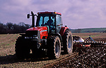 A728N0 Red tractor plouging field Suffolk England