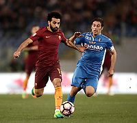 Calcio, Serie A: Roma, stadio Olimpico, 1 aprile, 2017.<br /> Roma's Mohamed Salah (l) in action with Empoli's Daniele Croce during the Italian Serie A football match between Roma and Empoli at Olimpico stadium, April 1, 2017<br /> UPDATE IMAGES PRESS/Isabella Bonotto