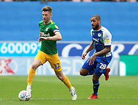 Preston North End's Paul Gallagher gets away rom Wigan Athletic's Leon Clarke<br /> <br /> Photographer David Shipman/CameraSport<br /> <br /> The EFL Sky Bet Championship - Wigan Athletic v Preston North End - Monday 22nd April 2019 - DW Stadium - Wigan<br /> <br /> World Copyright © 2019 CameraSport. All rights reserved. 43 Linden Ave. Countesthorpe. Leicester. England. LE8 5PG - Tel: +44 (0) 116 277 4147 - admin@camerasport.com - www.camerasport.com