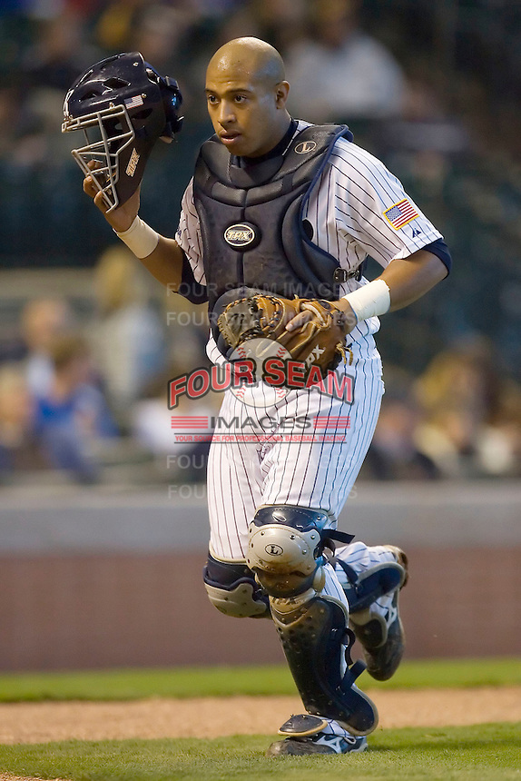 Diego Seastrunk #5 of the Rice Owls heads back to the dugout at the end of an inning versus the Baylor Bears in the 2009 Houston College Classic at Minute Maid Park March 1, 2009 in Houston, TX.  The Owls defeated the Bears 8-3. (Photo by Brian Westerholt / Four Seam Images)