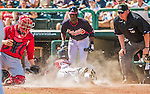 21 March 2015: Washington catcher Sandy Leon cannot get a sliding Jose Constanza out during a Spring Training Split Squad game against the Atlanta Braves at Champion Stadium at the ESPN Wide World of Sports Complex in Kissimmee, Florida. The Braves defeated the Nationals 5-2 in Grapefruit League play. Mandatory Credit: Ed Wolfstein Photo *** RAW (NEF) Image File Available ***