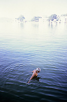 Pandeet, taking his morning bath in Lake Pichola, Udaipur, Rajasthan, India, 2011