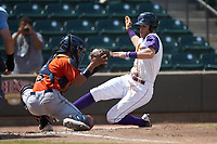 Buies Creek Astros catcher Carlos Canelon (8) can't handle the throw as Zach Remillard (7) of the Winston-Salem Dash slides towards home plate at BB&T Ballpark on July 15, 2018 in Winston-Salem, North Carolina. The Dash defeated the Astros 6-4. (Brian Westerholt/Four Seam Images)