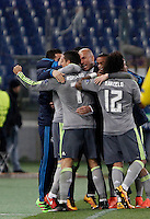 Calcio, andata degli ottavi di finale di Champions League: Roma vs Real Madrid. Roma, stadio Olimpico, 17 febbraio 2016.<br /> Real Madrid's Cristiano Ronaldo, left, back to camera, is hugged by coach Zinedine Zidane after scoring during the first leg round of 16 Champions League football match between Roma and Real Madrid, at Rome's Olympic stadium, 17 February 2016.<br /> UPDATE IMAGES PRESS/Isabella Bonotto
