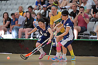 Australia&rsquo;s Kiahni Abell and Japan&rsquo;s Hitomi Sugaya in action during the World Floorball Championships 2017 Qualification for Asia Oceania Region Final - Australia v Japan at ASB Sports Centre , Wellington, New Zealand on Sunday 5 February 2017.<br /> Photo by Masanori Udagawa<br /> www.photowellington.photoshelter.com.