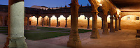 "Panoramic view of Cloister, Escuelas Menores (Minor Schools), 1428, University of Salamanca, Salamanca, Spain, pictured on December 18, 2010 in the evening, floodlit. Elegant arches surround a grassy quadrangle. Salamanca, an important Spanish University city, is known as La Ciudad Dorada (""The golden city"") because of the unique golden colour of its Renaissance sandstone buildings. Founded in 1218 its University is still one of the most important in Spain. Around it the Old Town is a UNESCO World Heritage Site. Picture by Manuel Cohen"