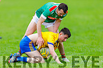 Ballymacs Tomás O'Connor under pressure from St Michaels Foilmore Brian Smith in the Junior Club Championship