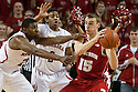 March 9, 2014: Leslee Smith (21) of the Nebraska Cornhuskers and David Rivers (2) of the Nebraska Cornhuskers trying to get the ball from Sam Dekker (15) of the Wisconsin Badgers during the second half at the Pinnacle Bank Arena, Lincoln, NE. Nebraska 77 Wisconsin 68.