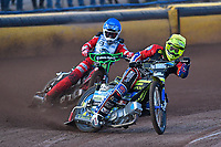 Heat 1 Paul Starke of Belle Vue Aces leads Kacper Woryna of Poole Pirates during Poole Pirates vs Belle Vue Aces, Elite League Speedway at The Stadium on 11th April 2018