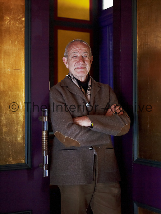 Designer Anthony Collett standing in the doorway of his London home