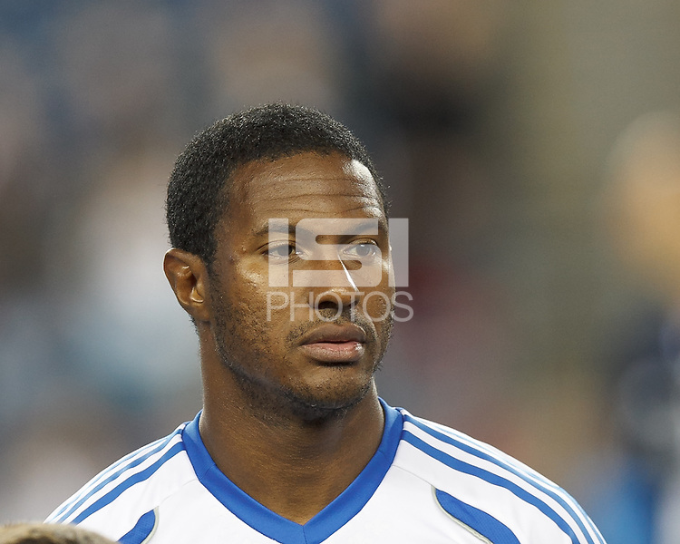 Montreal Impact midfielder Patrice Bernier (8). In a Major League Soccer (MLS) match, Montreal Impact (white/blue) defeated the New England Revolution (dark blue), 4-2, at Gillette Stadium on September 8, 2013.