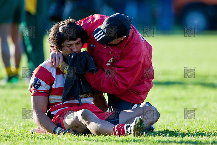 A very badly concussed Jamie Gilbert-Clark is attended to by Mark Gibb. Counties Manukau Premier Club Rugby semi final game between Pukekohe and Karaka, played at Colin Lawrie Fields Pukekohe on Saturday July 10th 2010.Pukekohe won 44 - 20 and will meet Waiuku in next weeks final at Growers Stadium.