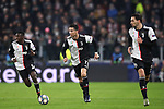 Cristiano Ronaldo of Juventus carries the ball forwards flanked by Blaise Matuidi and Mattia De Sciglio of Juventus during the UEFA Champions League match at Juventus Stadium, Turin. Picture date: 26th November 2019. Picture credit should read: Jonathan Moscrop/Sportimage
