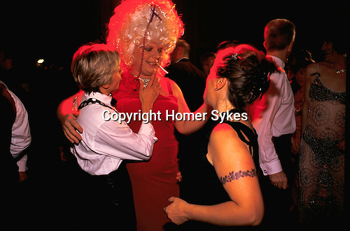 'GAYFEST MANCHESTER, UK', TWO LESBIANS AND A FAT TRANSVESTITE DRESSED IN SHOCKING PINK AT THE LAVENDER BALL,