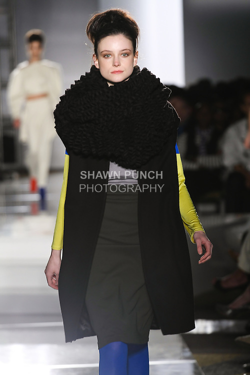 Model walks runway in an outfit by Rebecca Bauer, for the Parsons 2011 BFA Fashion Show, hosted by Reed Krakoff.