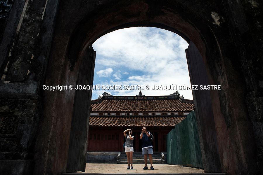 Two tourists take pictures in the imperial tomb of Minh Mang devoted entirely to painting, poetry and philosophy, in Hue (Vietnam)<br /> HUE-VIETNAM