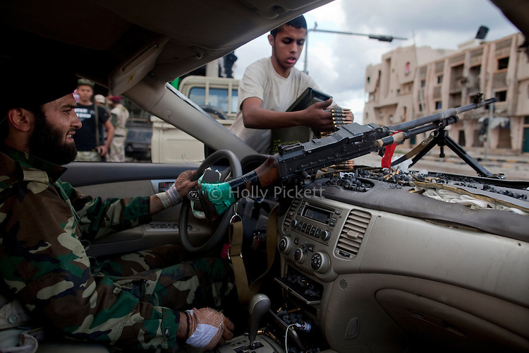 An anti-Gaddafi fighter mounted a weapon on the hood of his car, on Dubai Street, where pro-Gaddafi snipers took up positions to target revolutionary fighters in central Sirte, Libya, Oct. 13, 2011. Revolutionary forces solidified control of the pro-Gaddafi stronghold, but fighting continued in a few neighborhoods.